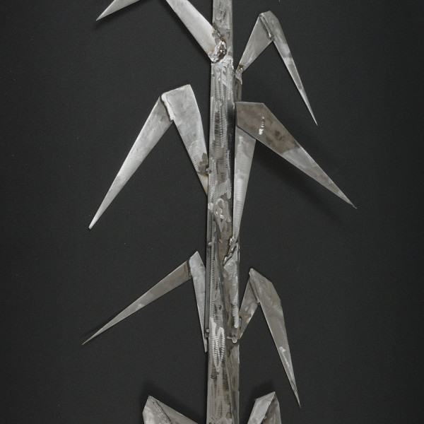 Cut steel welded together to show both humor in the floppy leaves and strength in the rigid material and sharp cut metal edges.