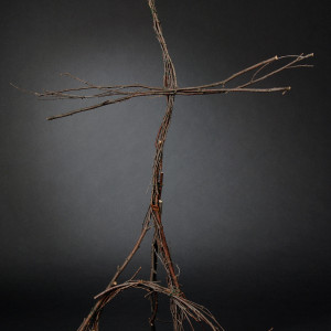 This is a 3-d cross made of twigs.