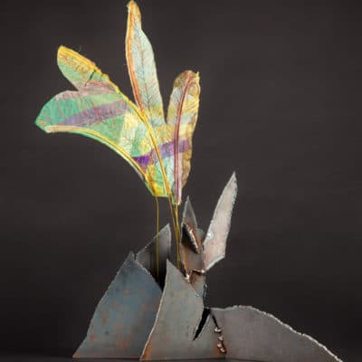 A welded steel base erupts into colorful fabric feathers.
