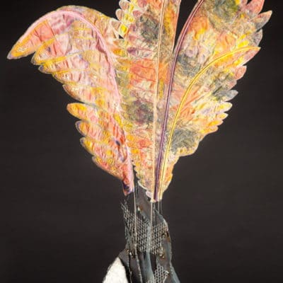 Welded steel base erupts into coloful delicate looking fabric wings.