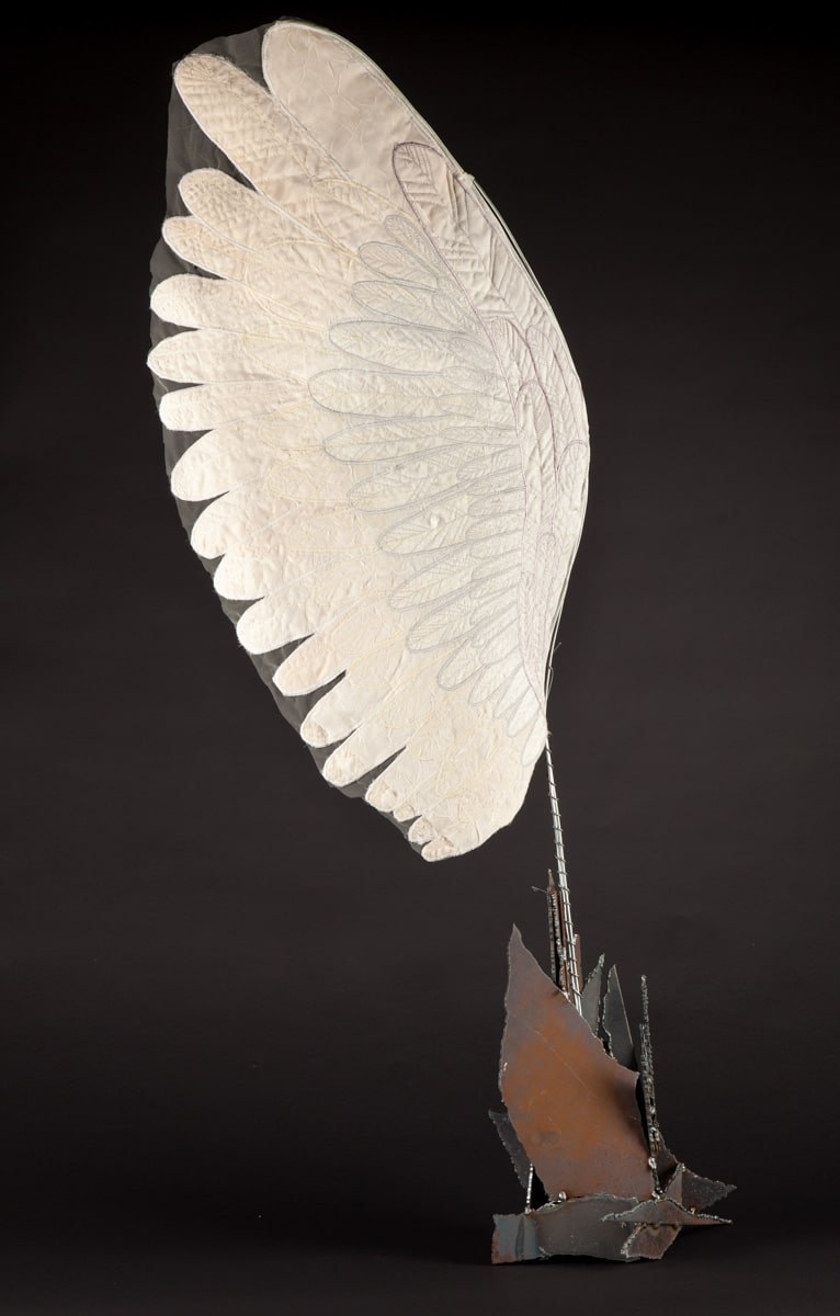 Welded steel base erupts into a delicate looking fabric wing.