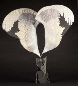 Welded steel base erupts into soft looking fabric wings.