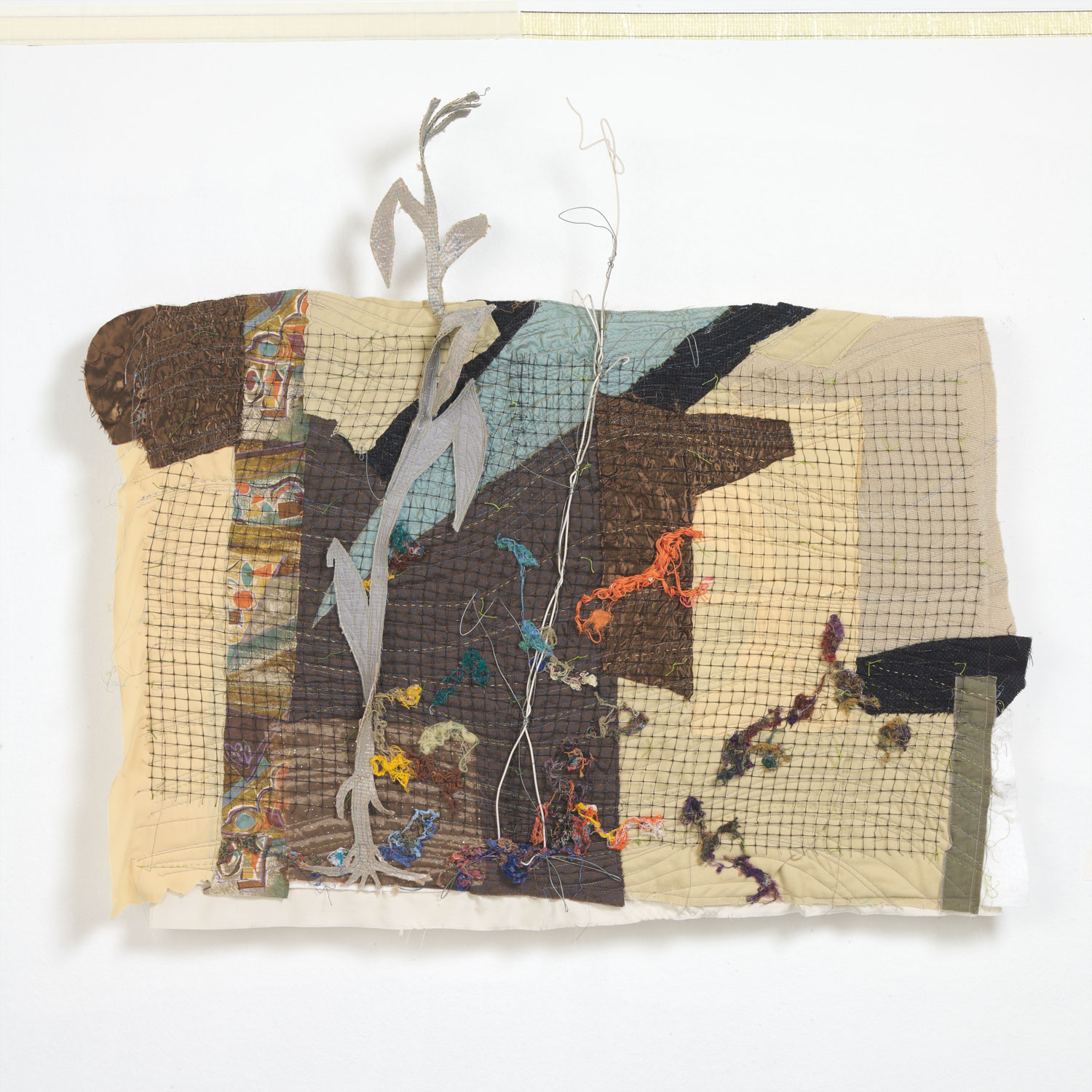 The Iowa flood of 2008 inspired this portrait of resiliance using mixed materials of fiber, wire and plastic mesh with hand and machine stitching.